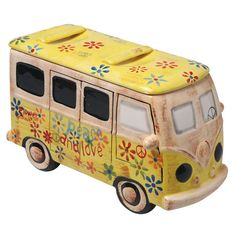 """HIPPIE DAYS VAN COOKIE JAR""  [Peace, love and chocolate chips, man! Lift the flowered lid off this detailed, retro van and reach in to grab some sweetness. Bright, nostalgic and absolutely necessary to have on-hand when the munchies strike. 7""H x 12 1/4""W X 6 1/2""D.]'h4d'121106"