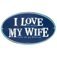 """Add humorous decor to your office or man cave withI Love My Wife Oval Embossed Tin Sign. This sign features a dark blue center and a turquoise blue border, along with embossed white text and light blue white accent text. Share two messages with one sign!        Dimensions:      Length: 6""""    Width: 10""""          Hanging Hardware:      2 - Nail Hole Cut-Outs (9 7/16"""" Apart from Center to Center)          Full Text: I love (it when) my ..."""