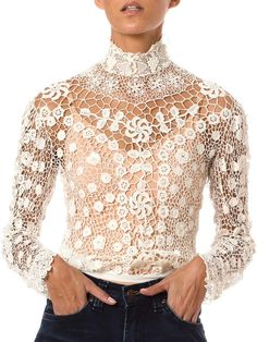 Product Description Measurements DETAILS This vintage lace white top form Ireland is fitted so that it gently hugs the torso up through the neckline. The garmen
