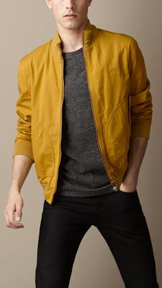 Shop this look for $124:  http://lookastic.com/men/looks/mustard-windbreaker-and-charcoal-crew-neck-t-shirt-and-black-skinny-jeans/1678  — Mustard Windbreaker  — Charcoal Crew-neck T-shirt  — Black Skinny Jeans