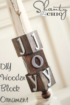 DIY wooden block ornaments ~ several steps including use of stain and a drill, but if you are handy at that you could easily change these up...l-o-v-e for Valentine's, for example