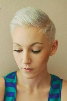 Ultra short women's crop with clipper cut sides. slight pompadour or spike it up top.