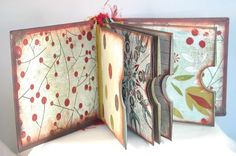 Christmas Pocket Book by Kathy  I like the idea that you could put pages inside the Pocket pages.