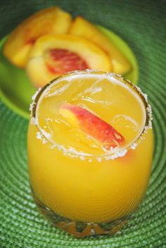 """peach margarita. Ready In: 10 Minutes Servings: 2 """"Both fresh and frozen peaches work in this frosty margarita, so you can enjoy it any time of the year."""" INGREDIENTS: 1 cup fresh peaches - peeled, pitted and sliced 3/4 cup peach nectar1 cup ice 2 fluid ounces tequila 2 fluid ounces triple sec DIRECTIONS: 1Place peaches, peach nectar, ice, tequila, and triple sec in a blender. Blend until smooth."""