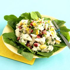 CONFETTI CRAB SALAD   1/4 cup(s) mayonnaise  1 medium lemon  juiced (use 2 tablespoons)  2 teaspoon mustard, Dijon  1 pounds crabmeat, jumbo lump, canned  1 medium pepper(s), red, bell  diced  1 medium pepper(s), yellow, bell  diced  1/4 cup(s) chives, fresh  chopped  1/4 cup(s) parsley, fresh  chopped  salt  to taste  peppercorns, black  freshly ground, to taste  8 cup(s) lettuce, mixed greens  baby greens preferred
