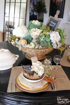 Succulents, ornamental cabbages, winter squash used with neutrals and a touch of glitz to create a stunning Thanksgiving tablescape. Design Dazzle