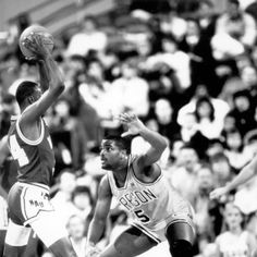Black and white photo of University of Oregon basketball player Randy Grant playing defense against Northern Arizona during a game played at Memorial Coliseum in Portland on December 26, 1987 and won by the Ducks 74-48. ©University of Oregon Libraries - Special Collections and University Archives Basketball History, Basketball Players, December 26, University Of Oregon, Home Team, Team Player, Libraries, Ducks, Portland