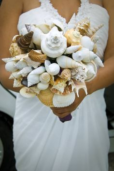 Not a bouquet I would choose but it's different. Never would have thought to make one of shells. Amazing shell bouquet for beach wedding