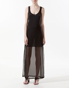 I love the sheer long skirt on this simple dress.
