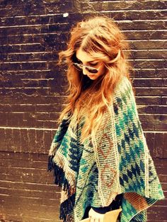 The poncho. A childhood staple, which I'm considering bringing back into my wardrobe this fall...
