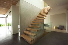 :: STAIRS :: lovely cantilevered stair detail and concrete wall feature ... frameless glazing detail adore.  Beautiful work by local Vancouver talents Chris Hunter of hunterOFFICE, custom wood treads by Christian Woo #stairs