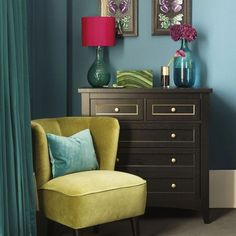Jewel-bright living room with yellow tub chair #livingroomdecorturquoise