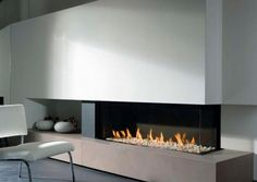 Modern Long Indoor Electric Fire Pit Ideas Insert Wall Glass Ideas As Well White Chair And Gray Floor Gorgeous Fire Pit Ideas as Rustic Modern Home Exterior http://seekayem.com