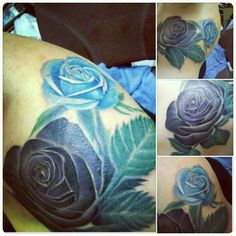 fuckyeahtattoos:  amandabearpig.tumblr.com Done by one of the most talented artists in San Diego, Cash Scott, owner of Chapter One Tattoo in Ocean Beach, CA. Black/purple rose is for my mom and the blue rose is for my dad. and I am in love with it.