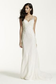 Breathtakingly beautiful, this exceptional illusion back sheath wedding dress is flawless!  Lace tank sheath gown with ultra-feminine v-neckline and beaded lace appliques features lace illusion low back.  Sweep train. Sizes 0P-14P. Available in Ivory and White.  Fully lined. Button closure. Imported polyester. Dry clean only.  Missy: Style SWG675. Sizes 0-14. ,000. Extra Length: Style 4XLSWG675. Sizes 0-14. ,000. Bothavailable for special order only in store and online. To preserve you...
