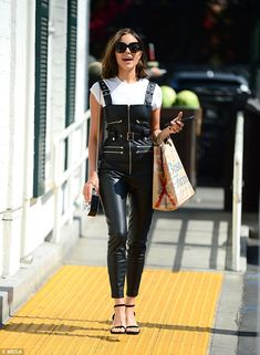 Glam: It came as no surprise to see Olivia Culpo taking a style risk and donning a pair of quirky leather dungarees as she headed out in Los Angeles on Wednesday