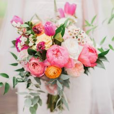 Bright and summery peony and garden rose bridal bouquet