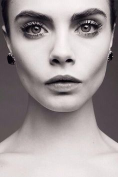 Cara Delevingne, cheekbones, expression, large defined brows, dark stud earrings, slightly pursed lip, eyes looking up and forward, lengthened neck, power