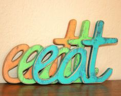 """Eat Sign....Kitchen, Dining room decor...Wood """"EAT"""" sign Our signs and frame colors match....Choose from 63 COLORS for your eat sign"""