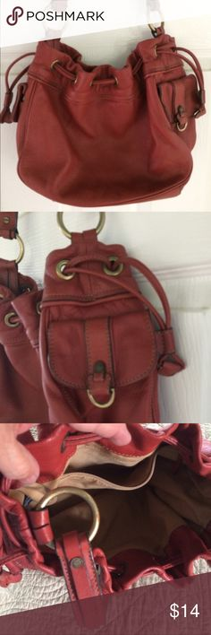 Ellen Tracy Rust color leather handbag Very nice leather handbag with quality brass hardware, side magnetic clasp pockets, & drawstring top closure & Inside zipper compartment. Very clean! Gently used! Ellen Tracy Bags Shoulder Bags