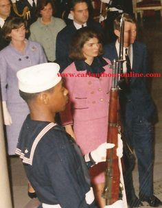 Still in the clothes she wore in Dallas at the time of the assassination, Jackie Kennedy returned to the White House in the early morning ho...