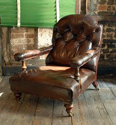 A Victorian buttoned leather gentleman's reading chair,