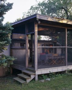 screened in porch with airstream trailer during summer