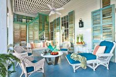 porch with vintage decor and bright blue painted floor, pantone cobalt blue color of the month august 2014