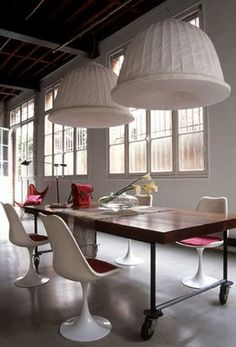 Industrial table and tulip chairs