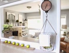 Love this vintage hanging scale in the kitchen kellyelko.com