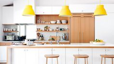 A California couple's experiment in modernism and minimalism leads to a open-layout kitchen that doubles as a living area.