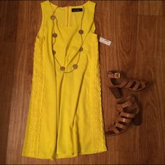 Yellow Dress This is a sad re-posh It's so pretty and perfect for spring and summer! I'm almost 5'4 and it comes down right above my knee, I was hoping it would be more mid thigh. It is light and flowy but not see through. NWT, purchased it that way and never wore it☀️ Feel free to make offers using the offer button! Dresses