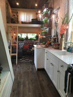 The oversized galley kitchen provides ample counter space and modern appliances. Next to the kitchen is Zack's custom wall garden with three planter boxes.