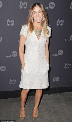 Sarah Jessica Parker in a white L'Agence shift, a bib necklace and pointy-toe Manolo Blahnik heels.