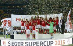 Bayern Munich gave new coach Carlo Ancelotti a winning start by beating arch-rivals Borussia Dortmund 2-0 to claim the German Supercup on Sunday.