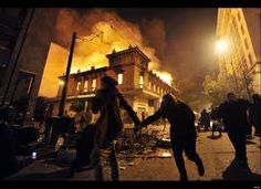 Bangs could be heard inside parliament and the tear gas drifting across the square reached the debating chamber. The night before several buildings had been set on fire, including a cinema, bank and a number of shops, and Greek television reported that dozens of citizens and at least 40 police officers had been injured.