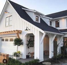 "awning above the garage, white garage, ""siding"" columns, dormers, goose neck light Exterior Garage Lights, Black Windows Exterior, White Exterior Houses, White Siding, House Paint Exterior, Exterior Siding, Exterior House Colors, Contemporary Farmhouse Exterior, White Farmhouse Exterior"