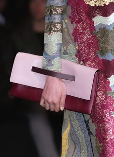 I absolutely love the strap on this clutch.