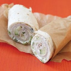 Stir cucumber into laughing cow cheese spread on tortillas, layer with turkey slices and roll up.