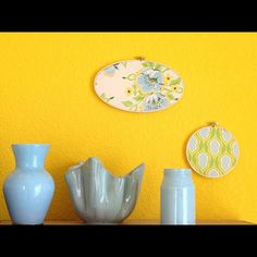 Pop some fabric in an embroidery hoop and paint the inside of some vases or jars for an inexpensive pop of color!