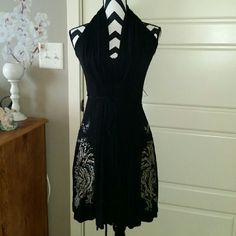 ED HARDY super sexy black dress This black halter top dress by ED HARDY is Japanese - inspired & oh so sexy! I bought it in Maui, Hawaii, * have nevrer seen one like it! :A major plus too is that it's super comfortable & looks fantastic on!! Ed Hardy Dresses Midi