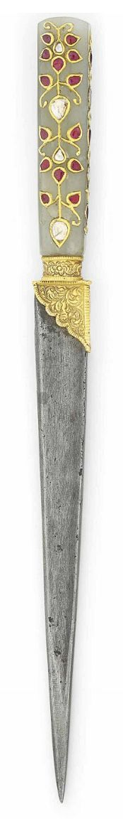 A GEMSET JADE-HILTED WATERED-STEEL DAGGER.   MUGHAL INDIA, LATE 18TH CENTURY   With single-edged blade, the hilt with floral tendrils with foiled rubies and foiled table-top cut diamonds, the hilt and blade possibly associated, with metal-thread embroidered sheath  9¾in. (25cm.) long
