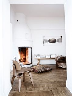 Eames DCW by the fire. (home of stefan söderberg)