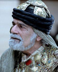 Omar Sharif as Abdullah from Elizabeth Peter's Amelia Peabody series.