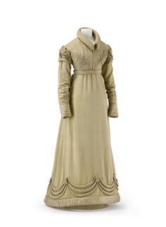 1820, England - Walking dress, composed of skirt and spencer, in light brown silk with fine pattern and voluminous trimming in silk satin