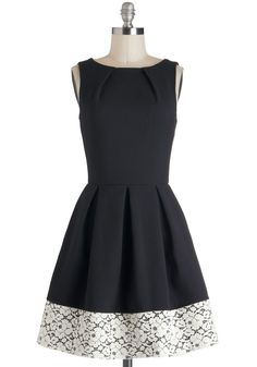 A-line silhouette and pleated details on this a Little Black Dress. LBD with lace band