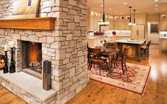 John Kraemer & Sons: professional builders and renovations of homes in Minnesota and Wisconsin. See their work in the Plymouth Kitchen Renovation. Double Sided Fireplace between kitchen and family room.