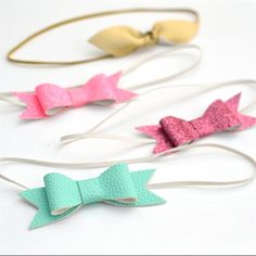 Handmade faux leather bow headbands just in time for Spring. Choose your bow color at checkout.Headbands are one size fits all made with super stretchy thin elastic. These headbands are the perfect accessory for babies, toddlers and young girls.**One size fits all.**