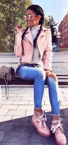 pretty cool fall outfit // pink moto jacket + sweater + rips + boots