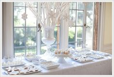 spray paint branches white and have in center of table--great focal point for tablescape